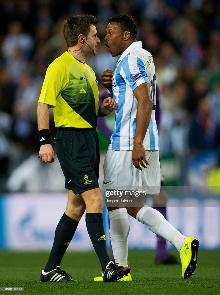 Julio Baptista (R) of Malaga CF argues with referee Nicola Rizzoli after his sides goal was disallowed during the UEFA Champions League Round of 16 second leg match between Malaga CF and FC Porto at La Rosaleda Stadium on March 13, 2013 in Malaga, Spain.