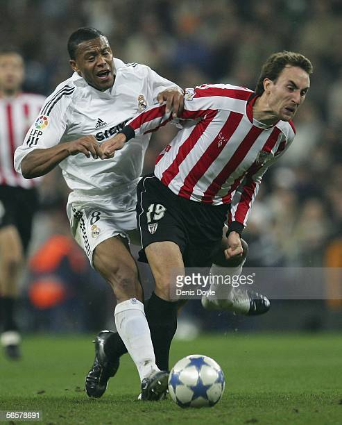 Julio Baptista of Real Madrid clashes with Murillo of Athletic Bilbao during the Copa del Rey Fifth Round Second Leg match between Real Madrid and...