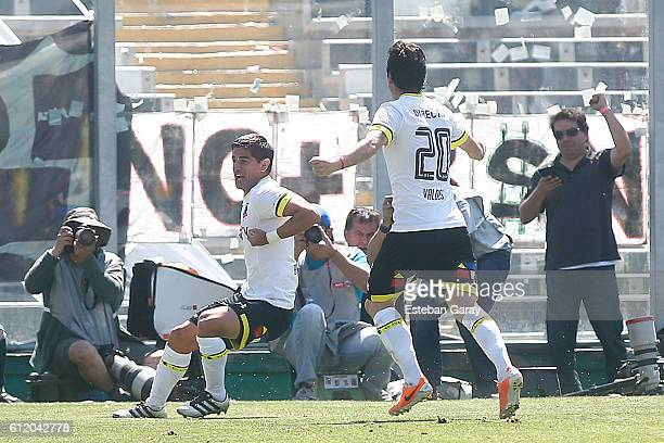 Julio Barroso of Colo Colo celebrates with teammates after scoring the first goal of his team during a match between Colo Colo and Universidad de...
