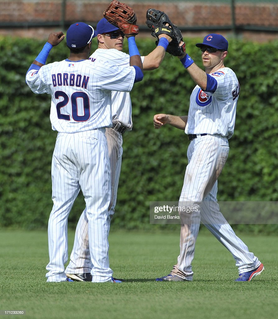 <a gi-track='captionPersonalityLinkClicked' href=/galleries/search?phrase=Julio+Borbon&family=editorial&specificpeople=4583545 ng-click='$event.stopPropagation()'>Julio Borbon</a> #20 of the Chicago Cubs, <a gi-track='captionPersonalityLinkClicked' href=/galleries/search?phrase=Ryan+Sweeney+-+Honkballer&family=editorial&specificpeople=711121 ng-click='$event.stopPropagation()'>Ryan Sweeney</a> #6 and <a gi-track='captionPersonalityLinkClicked' href=/galleries/search?phrase=Nate+Schierholtz&family=editorial&specificpeople=803208 ng-click='$event.stopPropagation()'>Nate Schierholtz</a> #19 L-R celebrate the Cubs win on June 23, 2013 at Wrigley Field in Chicago, Illinois. The Chicago Cubs defeated the Houston Astros 14-6.
