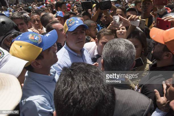 Julio Borges president of the National Assembly center and Henrique Capriles opposition leader and twotime presidential candidate left stand during...