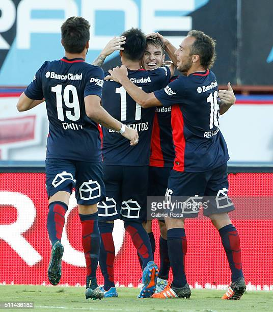Julio Buffarini of San Lorenzo and teammates celebrate after scoring the second goal of his team with a penalty kick during the 4th round match...