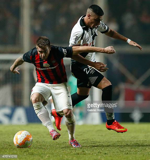 Julio Buffarini of San Lorenzo fights for the ball with Emiliano Ghan of Danubio during a match between San Lorenzo v Danubio as part of Copa...