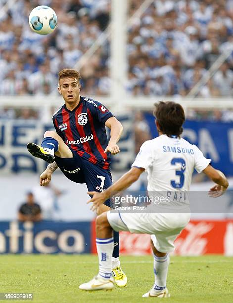 Julio Buffarini of San Lorenzo kicks the ball during a match between Velez Sarsfield and San Lorenzo as part of round 19 of Torneo Inicial 2013 at...