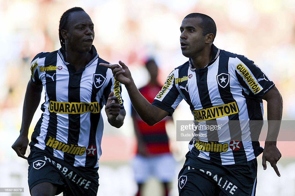 Julio Cesar (R) and Andrezinho (L) of Botafogo celebrate a goal against Flamengo during the match between Botafogo and Flamengo as part of Carioca Championship 2013 at Engenhao Stadium on March 03, 2013 in Rio de Janeiro, Brazil.