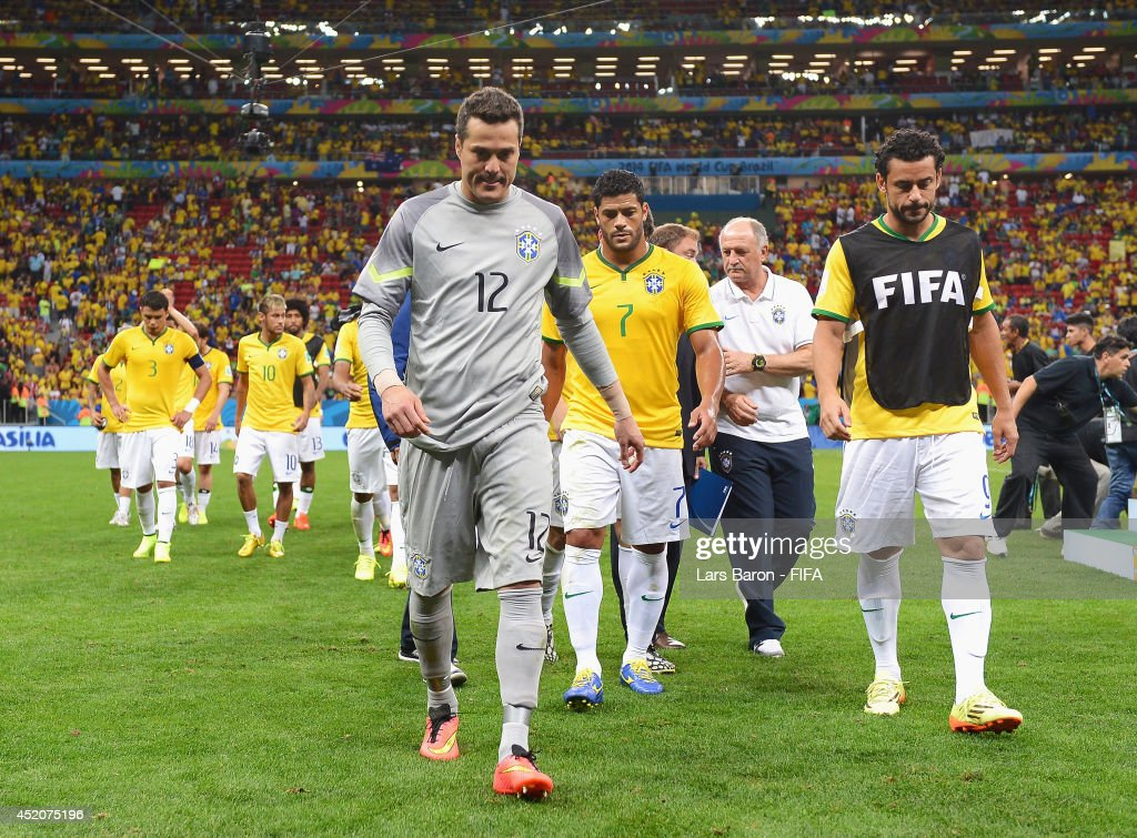 Julio Cesar (C) and players of Brazil walk off the pitch after the 2014 FIFA World Cup Brazil 3rd Place Playoff match between Brazil and Netherlands at Estadio Nacional on July 12, 2014 in Brasilia, Brazil.
