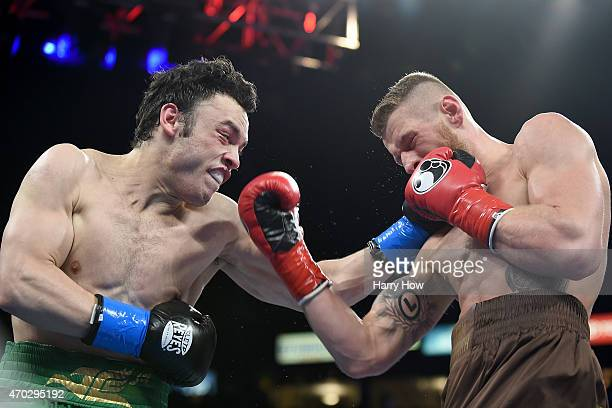 Julio Cesar Chavez Jr and Andrzej Fonfara exchange punches during the WBC light heavyweight title fight at StubHub Center on April 18 2015 in Los...
