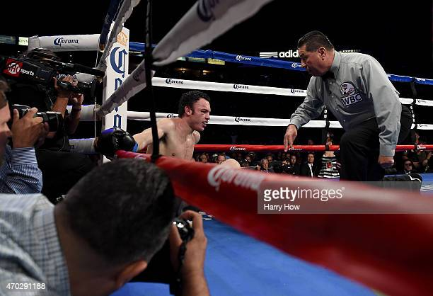 Julio Cesar Chavez Jr is given a count after a knockdown in the eighth round by Andrzej Fonfara during the WBC light heavyweight title fight at...