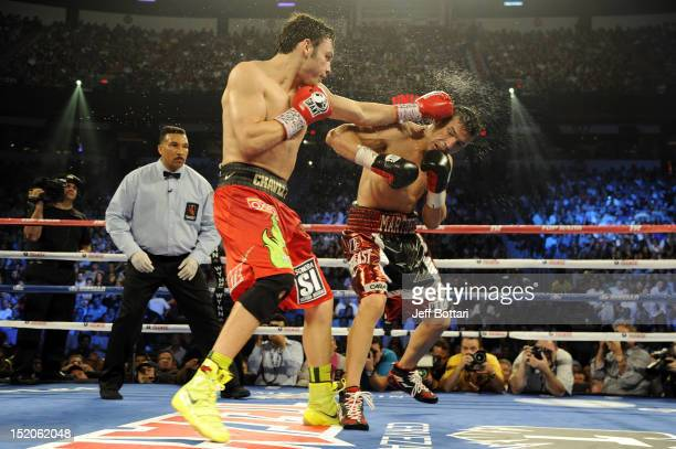 Julio Cesar Chavez Jr lands a left to the head of Sergio Martinez in the tenth round of their WBC middleweight title fight at the Thomas Mack Center...