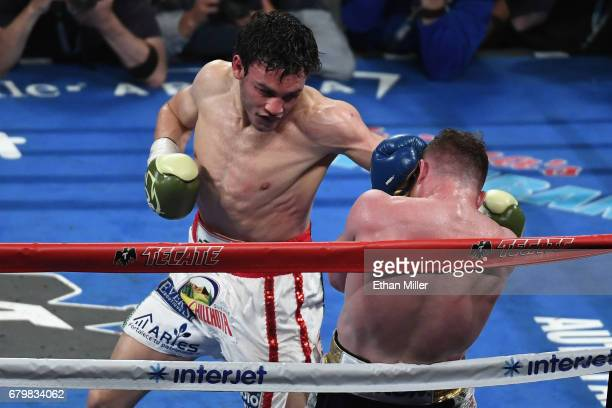 Julio Cesar Chavez Jr punches Canelo Alvarez during their catchweight bout at TMobile Arena on May 6 2017 in Las Vegas Nevada Alvarez won by...