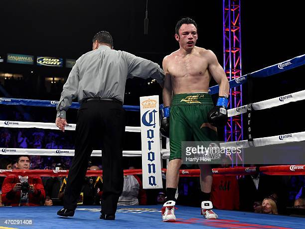 Julio Cesar Chavez Jr returns to his corner at the end of the eighth round after a knockdown from Andrzej Fonfara during the WBC light heavyweight...