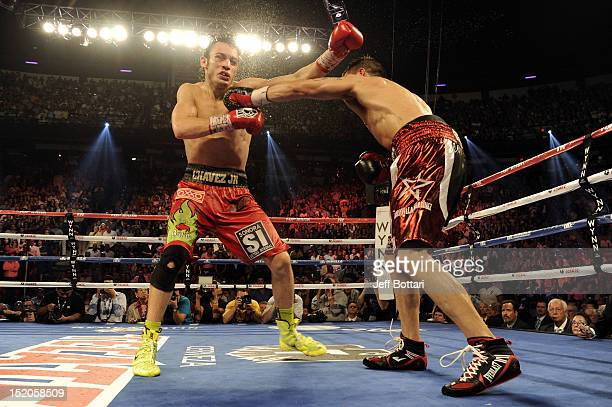 Julio Cesar Chavez Jr takes a left from Sergio Martinez in the 12th round of their WBC middleweight title fight at the Thomas Mack Center on...
