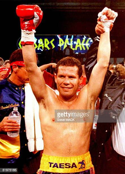 Julio Cesar Chavez of Culican Mexico raises his arms in victory after beating Scott Walker of Mesa Arizona 09 February Chavez won a second round TKO...