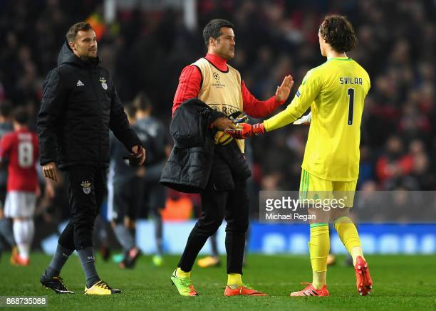 Julio Cesar consoles Mile Svilar of Benfica following his own goal during the UEFA Champions League group A match between Manchester United and SL...