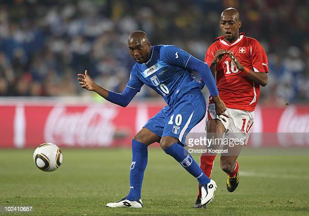 Julio Cesar de Leon of Honduras and Gelson Fernandes of Switzerland battle for the ball during the 2010 FIFA World Cup South Africa Group H match...