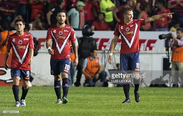 Julio Cesar Furch of Veracruz celebrates his goal against America with teammates Juan Angel Albin and Daniel Villava during their Mexican Clausura...