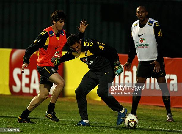 Julio Cesar holds off Kaka during the Brazil team training session at Randburg School on June 10 2010 in Johannesburg South Africa The Brazil...