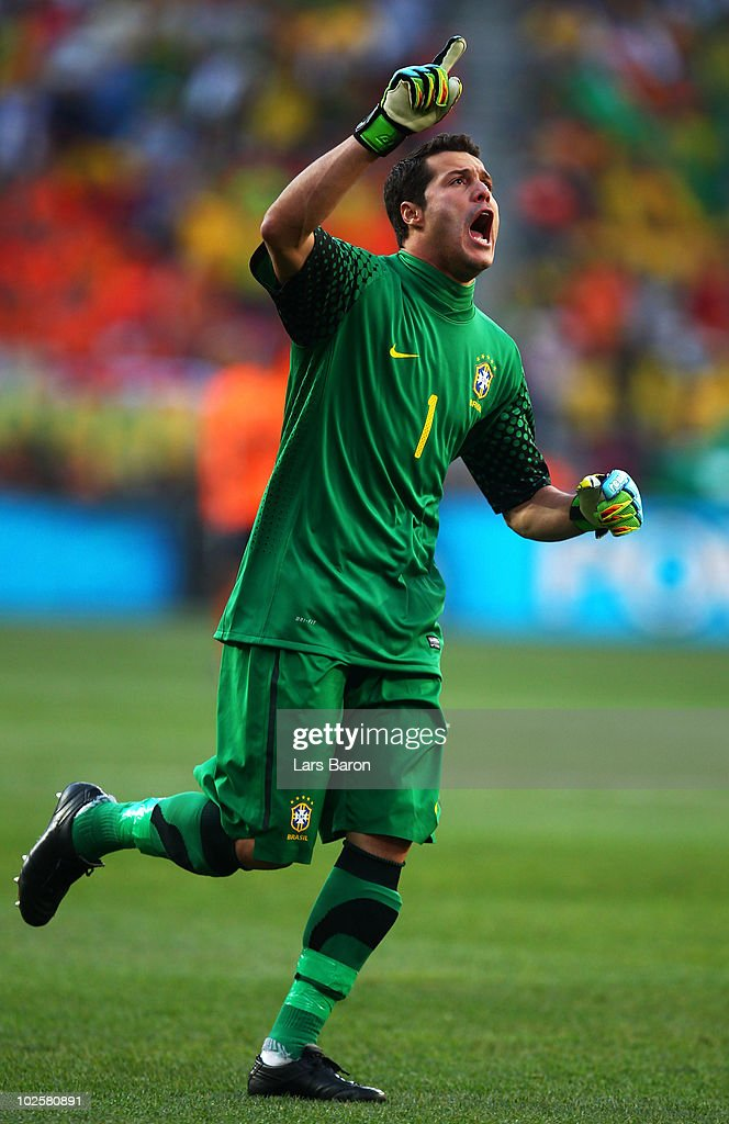 Julio Cesar of Brazil celebrates Robinho's opening goal during the 2010 FIFA World Cup South Africa Quarter Final match between Netherlands and Brazil at Nelson Mandela Bay Stadium on July 2, 2010 in Nelson Mandela Bay/Port Elizabeth, South Africa.