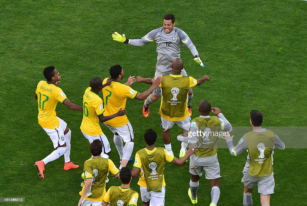 Julio Cesar of Brazil celebrates with teammates after defeating Chile in a penalty shootout during the 2014 FIFA World Cup Brazil round of 16 match between Brazil and Chile at Estadio Mineirao on June 28, 2014 in Belo Horizonte, Brazil.
