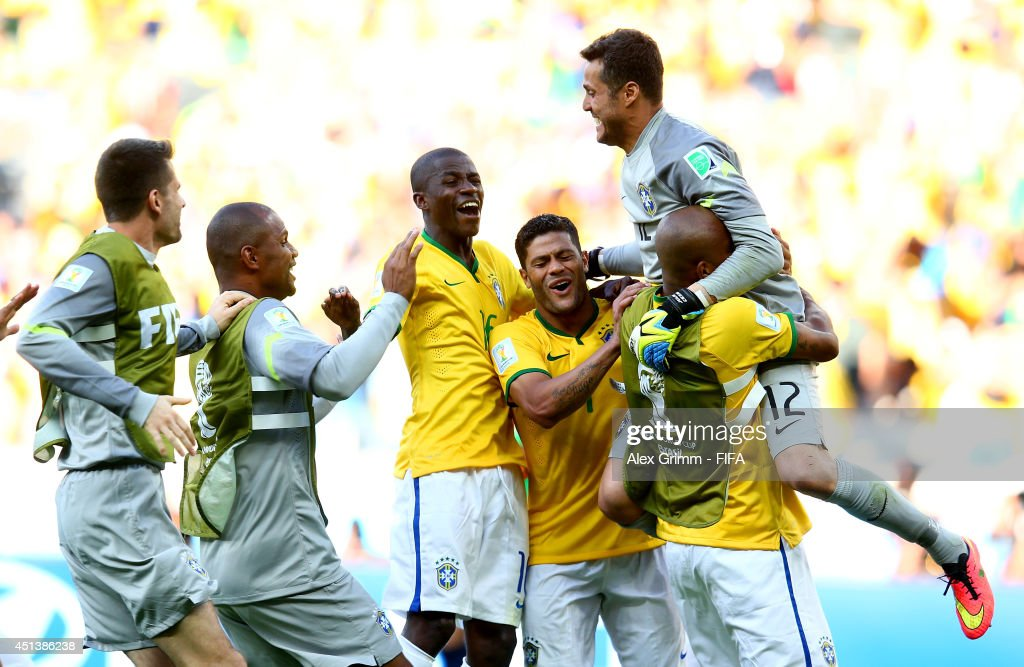 Julio Cesar (1st R) of Brazil is congratulated by his teammates after the win by the penalty shootout in the 2014 FIFA World Cup Brazil Round of 16 match between Brazil and Chile at Estadio Mineirao on June 28, 2014 in Belo Horizonte, Brazil.