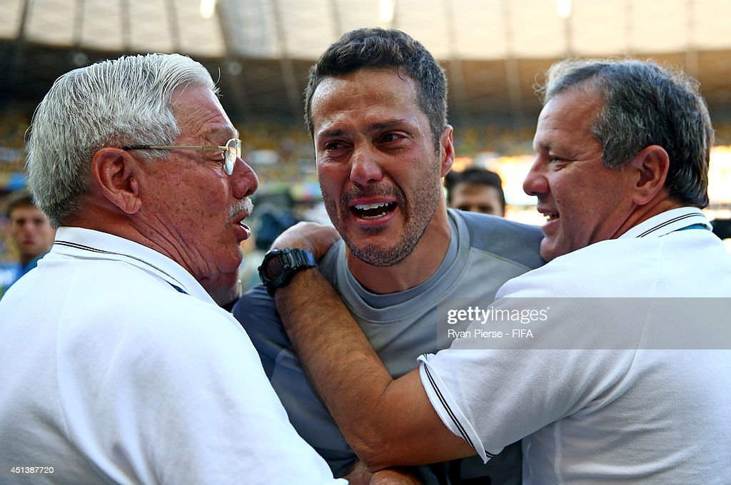 Julio Cesar (C) of Brazil is congratulated by team staffs as he walks off the pitch after the win in the 2014 FIFA World Cup Brazil Round of 16 match between Brazil and Chile at Estadio Mineirao on June 28, 2014 in Belo Horizonte, Brazil.