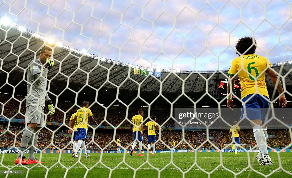 Julio Cesar of Brazil looks dejected after the opening goal scored by <a gi-track='captionPersonalityLinkClicked' href=/galleries/search?phrase=Thomas+Mueller&family=editorial&specificpeople=5842906 ng-click='$event.stopPropagation()'>Thomas Mueller</a> of Germany during the 2014 FIFA World Cup Brazil Semi Final match between Brazil and Germany at Estadio Mineirao on July 8, 2014 in Belo Horizonte, Brazil.