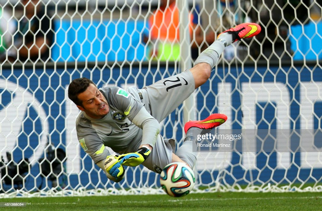 Julio Cesar of Brazil saves a penalty kick by Alexis Sanchez of Chile (not pictured) during the 2014 FIFA World Cup Brazil round of 16 match between Brazil and Chile at Estadio Mineirao on June 28, 2014 in Belo Horizonte, Brazil.