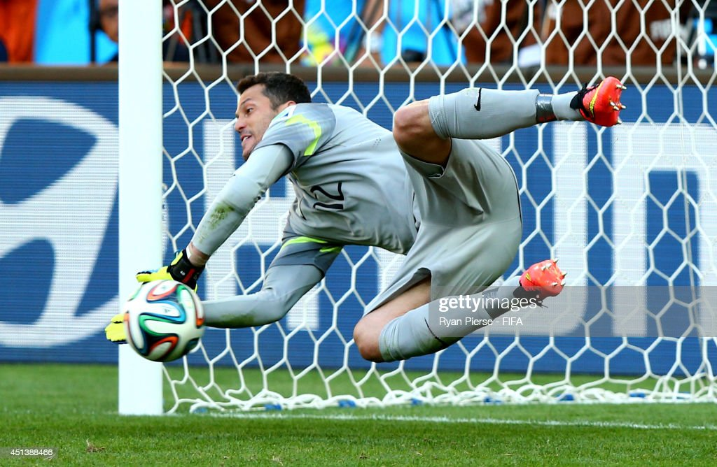 Julio Cesar of Brazil saves a penalty kick from Alexis Sanchez of Chile in a penalty shootout during the 2014 FIFA World Cup Brazil Round of 16 match between Brazil and Chile at Estadio Mineirao on June 28, 2014 in Belo Horizonte, Brazil.