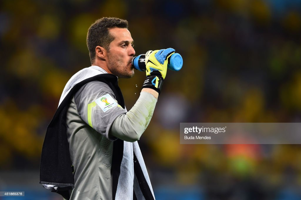 Julio Cesar of Brazil takes on fluids during the 2014 FIFA World Cup Brazil Semi Final match between Brazil and Germany at Estadio Mineirao on July 8, 2014 in Belo Horizonte, Brazil.