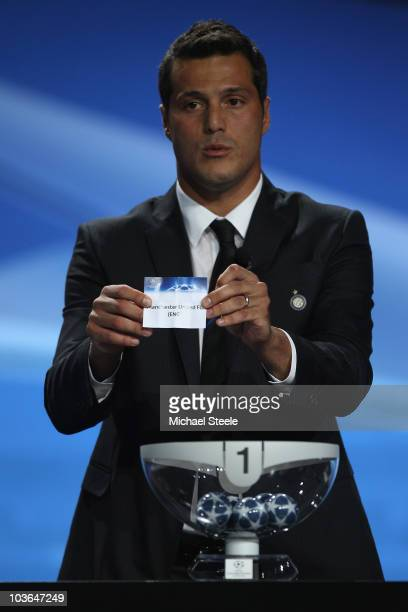 Julio Cesar of Inter Milan and Brazil draws the name of Manchester United during the UEFA Champions League Group Stage draw at the Grimaldi Forum on...