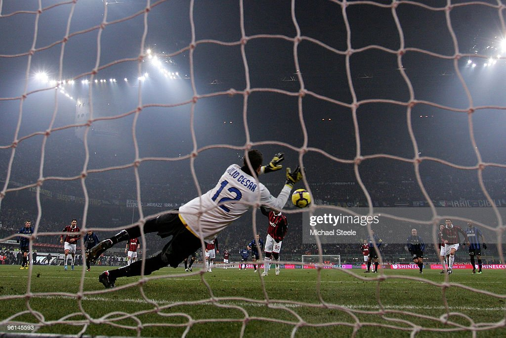 Julio Cesar of Inter saves a penalty from Ronaldhino of Milan during the Serie A match between Inter Milan and AC Milan at Stadio Giuseppe Meazza on January 24, 2010 in Milan, Italy.