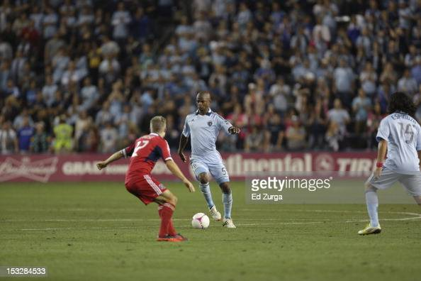 Julio Cesar of the Sporting Kansas City works the ball against Logan Pause of the Chicago Fire in the first half at Livestrong Sporting Park on...