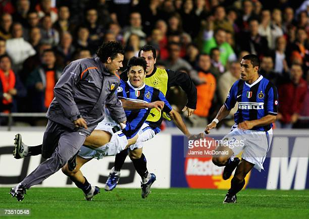Julio Cruz of Inter Milan trys to kick David Navarro of Valencia as the game gets out of control at the final whistle of the UEFA Champions League...
