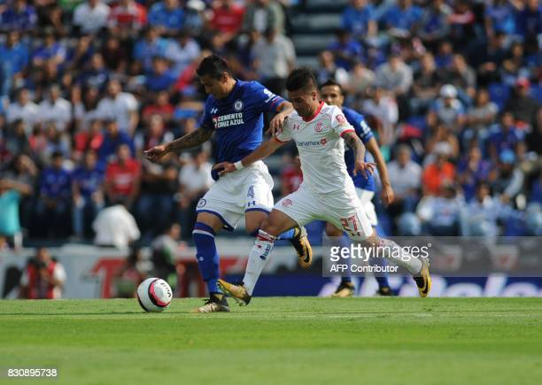 Julio Dominguez of Cruz Azul vies for the ball with Rodrigo Gomez of Toluca during their Mexican Torneo Apertura 2017 football match at Azul Stadium...