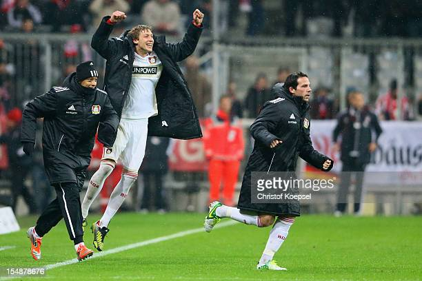 Julio Fernandez Stefan Kiessling and Gonzalo Castro of Leverkusen celebrate the 21 victory after the Bundesliga match between FC Bayern Muenchen and...
