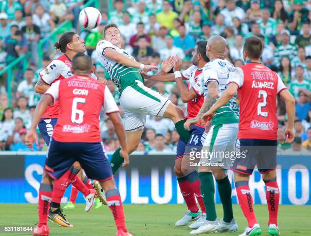 Julio Furch of Santos jumps for a header during the 4th round match between Santos Laguna and Veracruz as part of the Torneo Apertura 2017 Liga MX on...