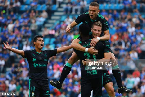 Julio Furch of Santos Laguna celebrate with teammates after scoring the first goal of his team during the 9th round match between Cruz Azul and...