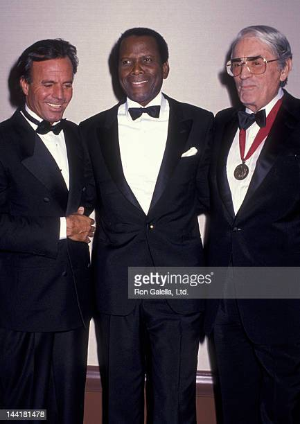 Julio Iglesias Sidney Poitier and Gregory Peck attend Scopus Awards Gala on January 15 1989 at the Beverly Hilton Hotel in Beverly Hills California