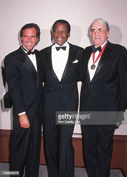 Julio Iglesias Sidney Poitier and Gregory Peck during Johnny Carson Gala at Beverly Hilton Hotel in Beverly Hills California United States