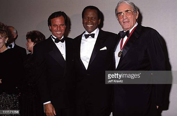 Julio Iglesias Sidney Poitier Gregory Peck during Tribute to Cary Grant in Beverly Hills California United States