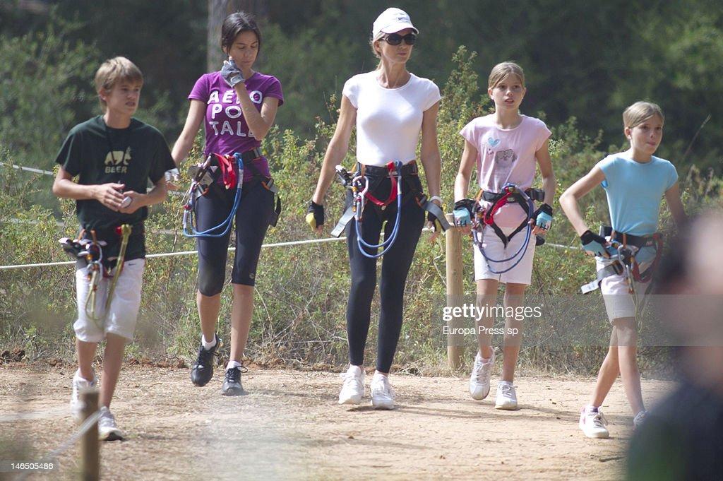 Julio Iglesias' wife Miranda Rinsjburger and her daughters Victoria Iglesias (R), Cristina Iglesias (2R) and Rodrigo Iglesias (L) are seen playing with tirolina on June 5, 2012 in Marbella, Spain.