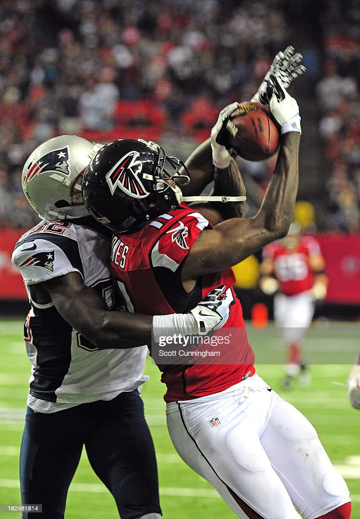 <a gi-track='captionPersonalityLinkClicked' href=/galleries/search?phrase=Julio+Jones&family=editorial&specificpeople=5509837 ng-click='$event.stopPropagation()'>Julio Jones</a> #11 of the Atlanta Falcons catches a pass against <a gi-track='captionPersonalityLinkClicked' href=/galleries/search?phrase=Devin+McCourty&family=editorial&specificpeople=4510365 ng-click='$event.stopPropagation()'>Devin McCourty</a> #32 of the New England Patriots at the Georgia Dome on September 29, 2013 in Atlanta, Georgia.