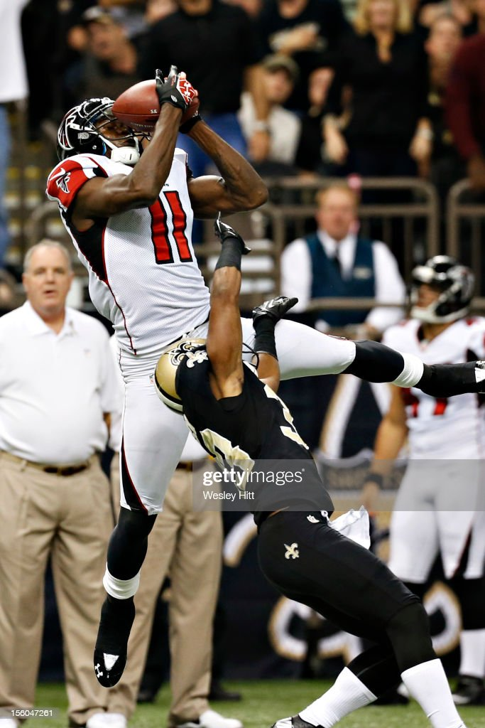 <a gi-track='captionPersonalityLinkClicked' href=/galleries/search?phrase=Julio+Jones&family=editorial&specificpeople=5509837 ng-click='$event.stopPropagation()'>Julio Jones</a> #11 of the Atlanta Falcons catches a pass over <a gi-track='captionPersonalityLinkClicked' href=/galleries/search?phrase=Jabari+Greer&family=editorial&specificpeople=2112639 ng-click='$event.stopPropagation()'>Jabari Greer</a> #33 of the New Orleans Saints at Mercedes-Benz Superdome on November 11, 2012 in New Orleans, Louisiana. The Saints defeated the Falcons 31-27.