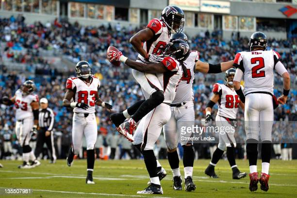 Julio Jones of the Atlanta Falcons celebrates after scoring a touchdown with teammate Roddy White during their game against the Carolina Panthers at...