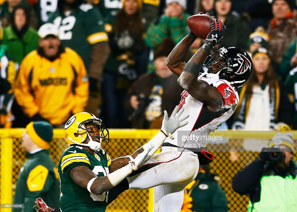 Julio Jones of the Atlanta Falcons completes a touchdown reception against Sam Shields of the Green Bay Packers in the fourth quarter at Lambeau...