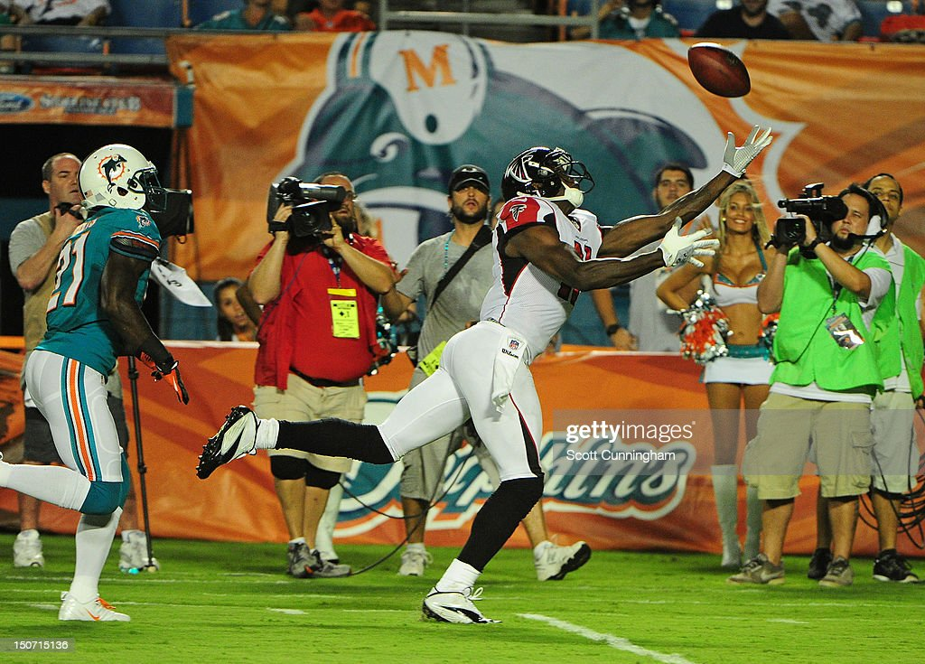 <a gi-track='captionPersonalityLinkClicked' href=/galleries/search?phrase=Julio+Jones&family=editorial&specificpeople=5509837 ng-click='$event.stopPropagation()'>Julio Jones</a> #11 of the Atlanta Falcons is unable to make a catch against the Miami Dolphins at Sun Fife Stadium on August 24, 2012 in Miami Gardens, Florida.