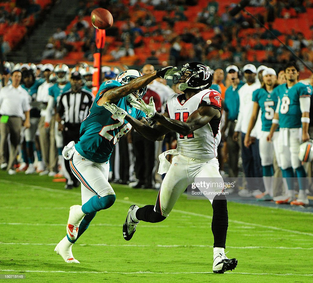 <a gi-track='captionPersonalityLinkClicked' href=/galleries/search?phrase=Julio+Jones&family=editorial&specificpeople=5509837 ng-click='$event.stopPropagation()'>Julio Jones</a> #11 of the Atlanta Falcons is unable to make a catch against <a gi-track='captionPersonalityLinkClicked' href=/galleries/search?phrase=Nolan+Carroll&family=editorial&specificpeople=5574471 ng-click='$event.stopPropagation()'>Nolan Carroll</a> #28 of the Miami Dolphins at Sun Fife Stadium on August 24, 2012 in Miami Gardens, Florida.