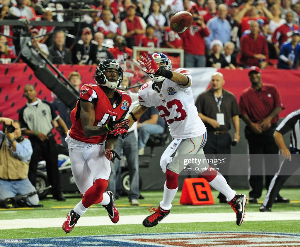 <a gi-track='captionPersonalityLinkClicked' href=/galleries/search?phrase=Julio+Jones&family=editorial&specificpeople=5509837 ng-click='$event.stopPropagation()'>Julio Jones</a> #11 of the Atlanta Falcons looks to make a catch for a second half touchdown against <a gi-track='captionPersonalityLinkClicked' href=/galleries/search?phrase=Corey+Webster&family=editorial&specificpeople=664907 ng-click='$event.stopPropagation()'>Corey Webster</a> #23 of the New York Giants at the Georgia Dome on December 16, 2012 in Atlanta, Georgia