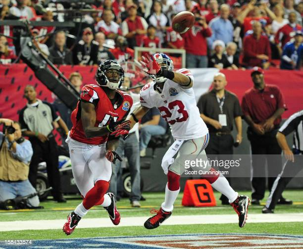 Julio Jones of the Atlanta Falcons looks to make a catch for a second half touchdown against Corey Webster of the New York Giants at the Georgia Dome...