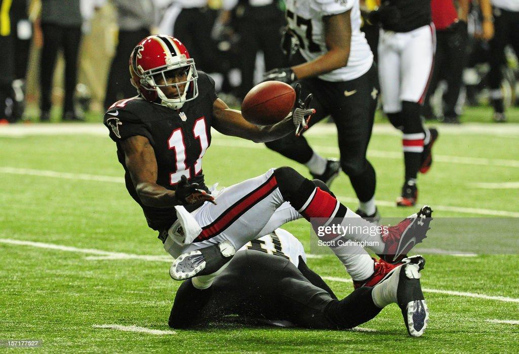 Julio Jones #11 of the Atlanta Falcons makes a catch against the New Orleans Saints at the Georgia Dome on November 29, 2012 in Atlanta, Georgia